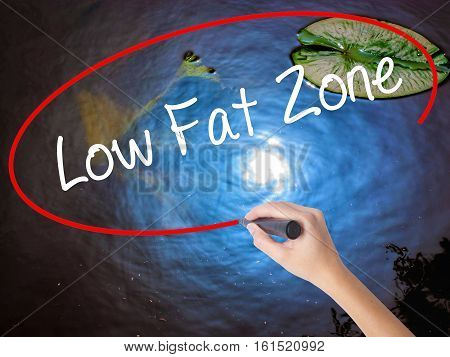 Woman Hand Writing Low Fat Zone With Marker Over Transparent Board