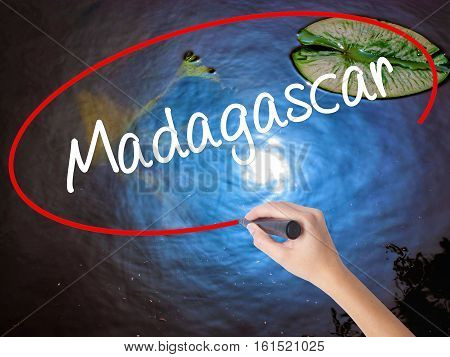Woman Hand Writing Madagascar With Marker Over Transparent Board