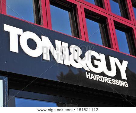 BUDAPEST HUNGARY - JUNE 8: Logotype of Tony&Guy hairdressing salon in Budapest on June 8 2016. DHL