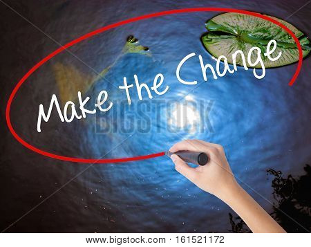 Woman Hand Writing Make The Change With Marker Over Transparent Board