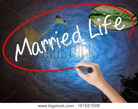 Woman Hand Writing Married Life With Marker Over Transparent Board