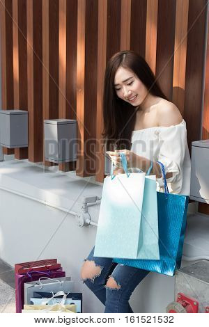 Happy Asian Woman With Colorful Shopping Bags At Department Store Shopping Mall