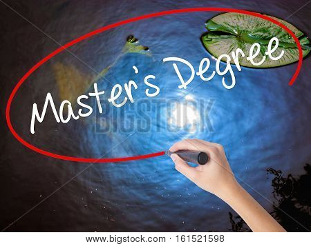 Woman Hand Writing Master's Degree With Marker Over Transparent Board.