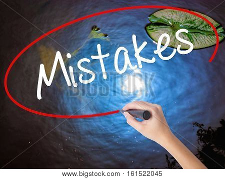 Woman Hand Writing  Mistakes With Marker Over Transparent Board