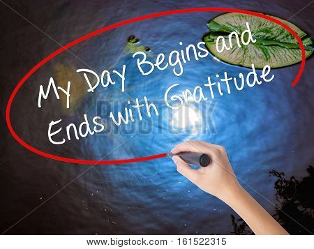 Woman Hand Writing My Day Begins And Ends With Gratitude With Marker Over Transparent Board