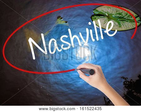 Woman Hand Writing Nashville With Marker Over Transparent Board