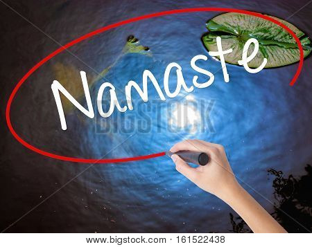 Woman Hand Writing Namaste With Marker Over Transparent Board