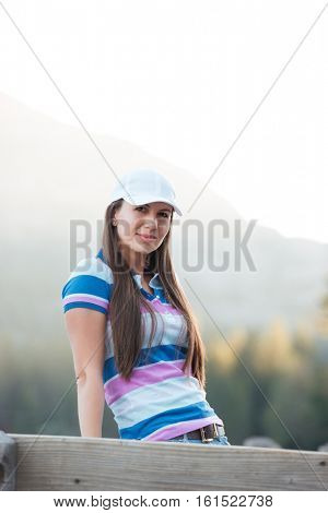 Portrait of an attractive young woman in hat on a holday in mountains