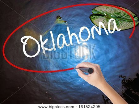Woman Hand Writing Oklahoma With Marker Over Transparent Board