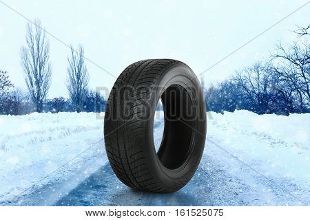 Car tire on road. Winter tires concept.