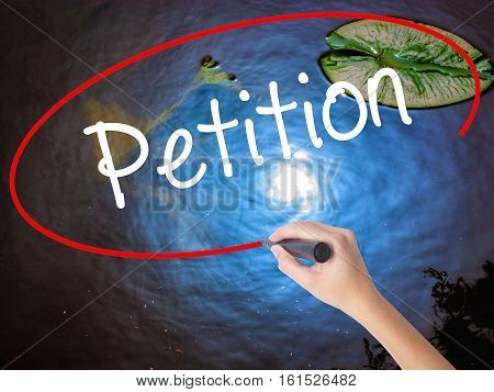 Woman Hand Writing Petition With Marker Over Transparent Board