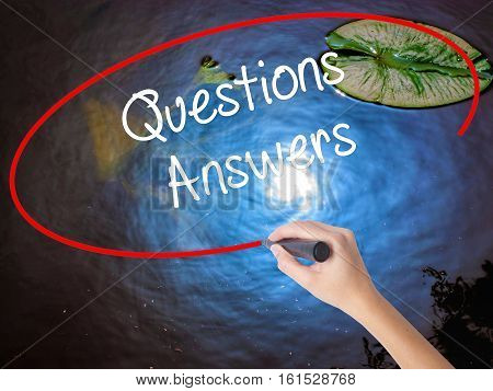 Woman Hand Writing Questions Answers With Marker Over Transparent Board