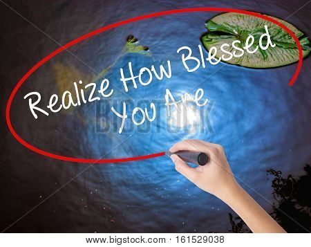 Woman Hand Writing  Realize How Blessed You Are  With Marker Over Transparent Board