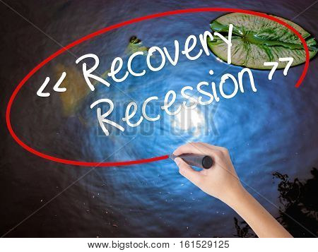Woman Hand Writing  Recovery - Recession With Marker Over Transparent Board