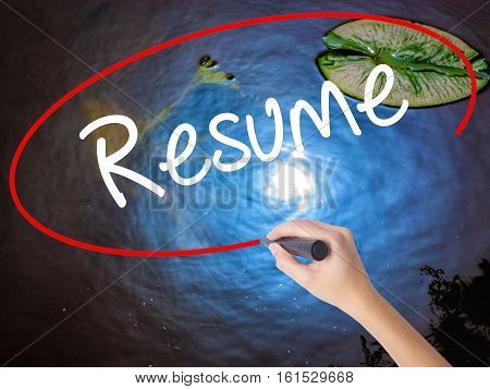 Woman Hand Writing Resume With Marker Over Transparent Board