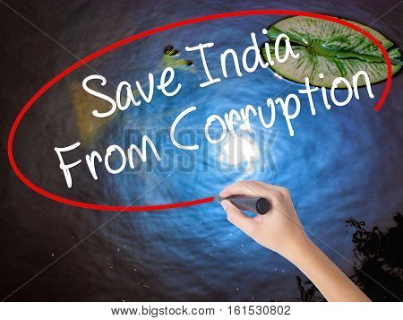 Woman Hand Writing Save India From Corruption With Marker Over Transparent Board