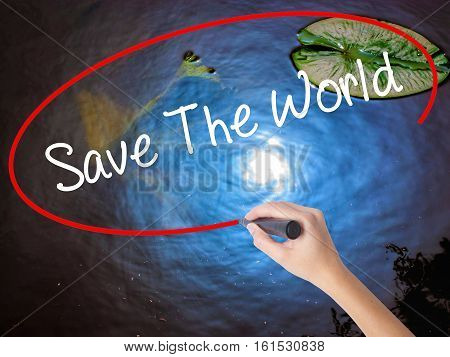 Woman Hand Writing Save The World With Marker Over Transparent Board.