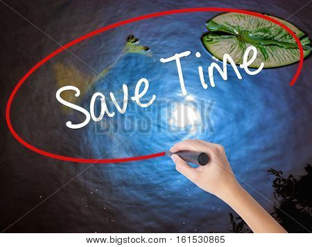 Woman Hand Writing Save Time With Marker Over Transparent Board