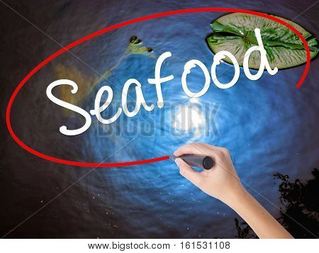 Woman Hand Writing Seafood With Marker Over Transparent Board