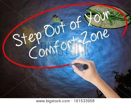 Woman Hand Writing  Step Out Of Your Comfort Zone With Marker Over Transparent Board.