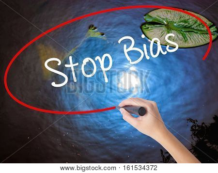 Woman Hand Writing Stop Bias With Marker Over Transparent Board