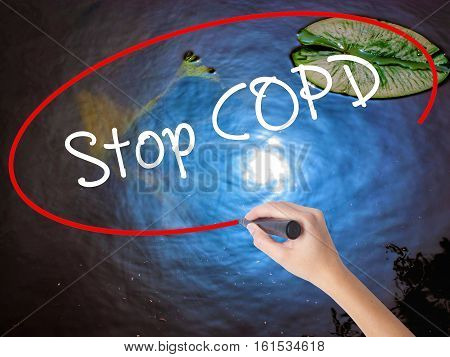 Woman Hand Writing Stop Copd With Marker Over Transparent Board