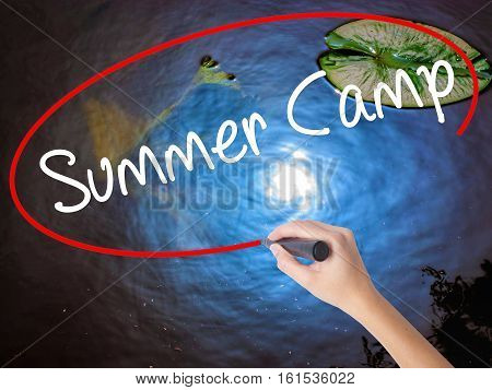 Woman Hand Writing Summer Camp With Marker Over Transparent Board