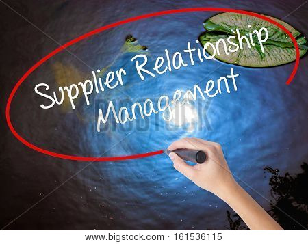 Woman Hand Writing Supplier Relationship Management With Marker Over Transparent Board.