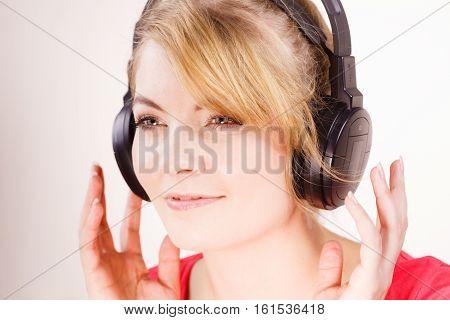 Woman In Big Headphones Listening Music