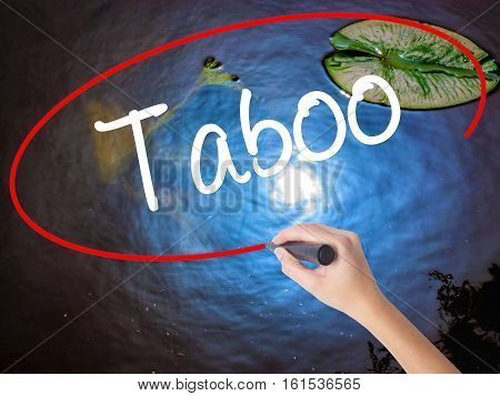 Woman Hand Writing Taboo With Marker Over Transparent Board