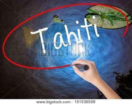 Woman Hand Writing Tahiti With Marker Over Transparent Board