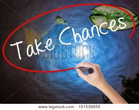 Woman Hand Writing Take Chances With Marker Over Transparent Board.