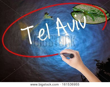 Woman Hand Writing Tel Aviv  With Marker Over Transparent Board