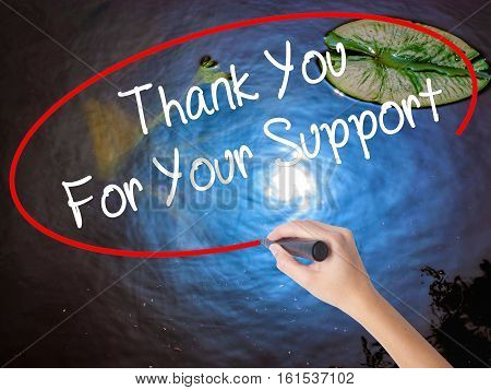Woman Hand Writing Thank You For Your Support  With Marker Over Transparent Board