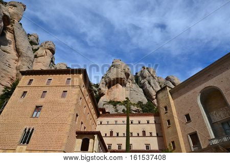 The Benedictine Monastery of Montserrat (Monasterio de Montserrat) is a recognized landmark in Spain. Today the monastery is the spiritual centre of Catalonia and a place of pilgrimage. Located Montserrat Monastery high in the mountains