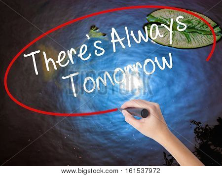 Woman Hand Writing There's Always Tomorrow  With Marker Over Transparent Board