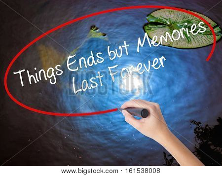 Woman Hand Writing Things Ends But Memories Last Forever With Marker Over Transparent Board