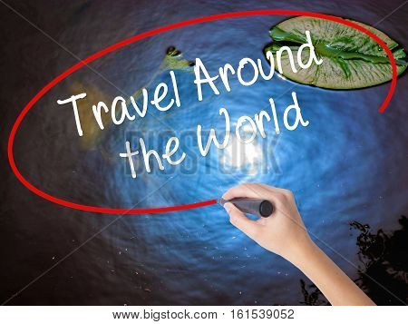 Woman Hand Writing Travel Around The World With Marker Over Transparent Board