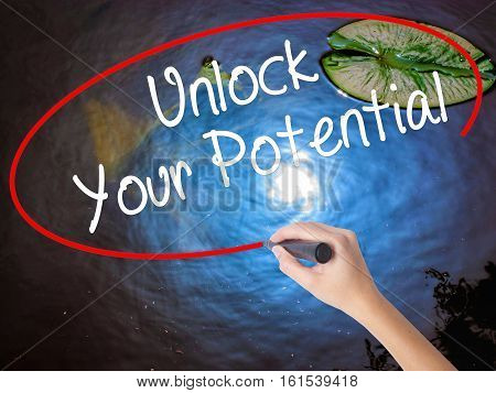 Woman Hand Writing Unlock Your Potential With Marker Over Transparent Board