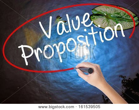 Woman Hand Writing Value Proposition With Marker Over Transparent Board