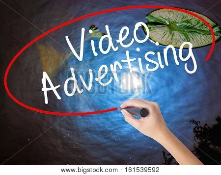 Woman Hand Writing Video Advertising With Marker Over Transparent Board