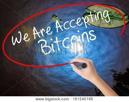 Woman Hand Writing We Are Accepting Bitcoins With Marker Over Transparent Board