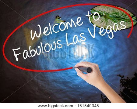Woman Hand Writing Welcome To Fabulous Las Vegas With Marker Over Transparent Board