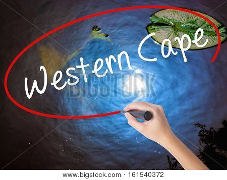 Woman Hand Writing Western Cape With Marker Over Transparent Board.