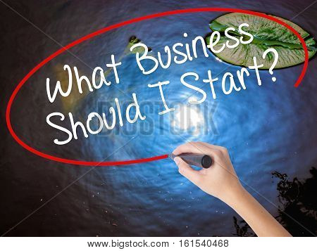 Woman Hand Writing What Business Should I Start? With Marker Over Transparent Board