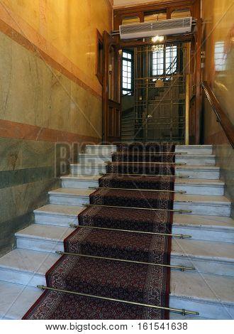 entry steps to old hotel building with antique elevator Stockholm Sweden