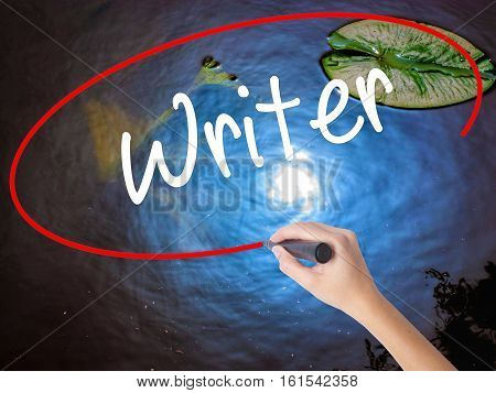 Woman Hand Writing Writer With Marker Over Transparent Board