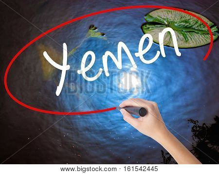 Woman Hand Writing  Yemen  With Marker Over Transparent Board