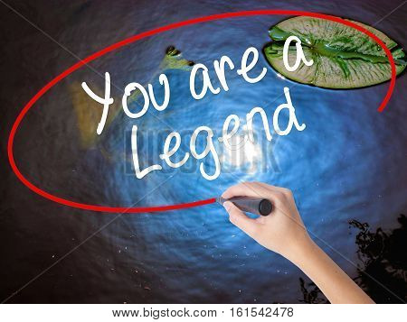 Woman Hand Writing You Are A Legend   With Marker Over Transparent Board