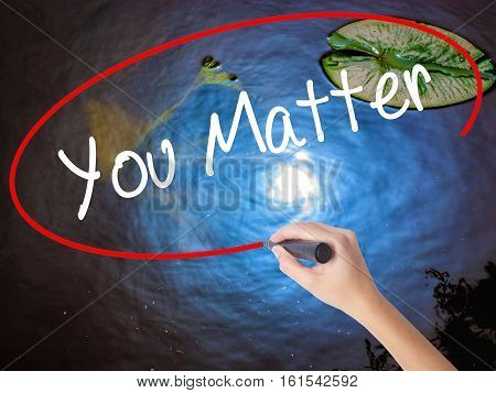 Woman Hand Writing You Matter With Marker Over Transparent Board